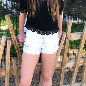 White High waisted distressed shorts